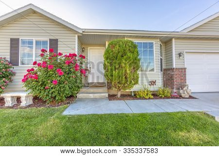 Exterior Of One Storey Single Family Home With A Beautiful Front Garden