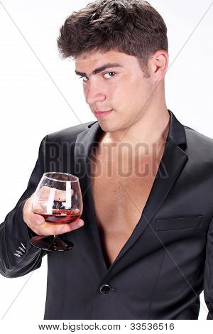 Man With Glass Of Cognac On White Background