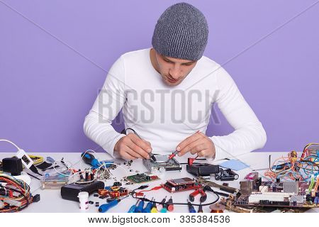 Picture Of Radiotrician Doing Technologigal Tests Using Multimeter As Electronic Equipment, Being At