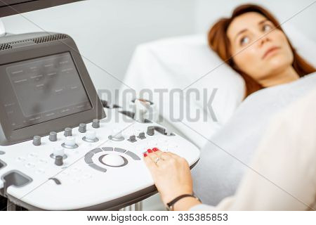 Woman Examining Her Pelvic Organs With Ultrasound Sensor Or Diagnosing Early Pregnancy At The Medica