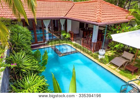 Sri Lanka - Nov 4, 2017: Nice Villa At Tropical Hotel. Idyllic Scenic Courtyard With Swimming Pool.