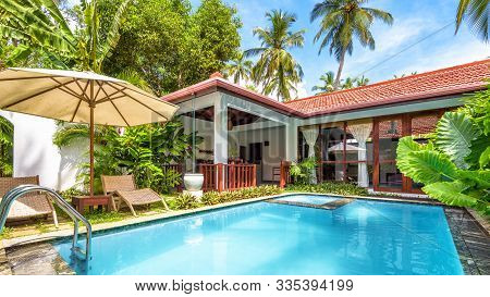 Sri Lanka - Nov 4, 2017: Swimming Pool In Tropical Hotel Or House. Panoramic Scenic View Of Nice Cou
