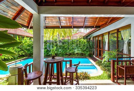 Sri Lanka - Nov 4, 2017: Scenery Of Luxury Villa Among Palm Trees. Swimming Pool With Garden At Trop