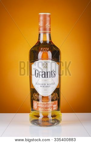 Grants Rum Cask Finish Whisky On Gradient Background.  Grants Has Been Produced By William Grants An