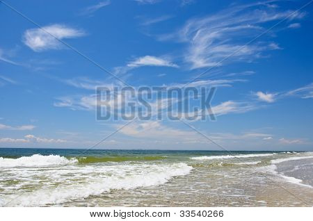 Wave and clouds wich beach and sea