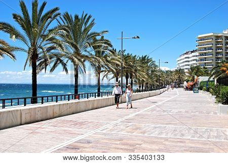 Marbella, Spain - May 26, 2008 - Tourists Walking Along The Promenade Alongside Daitona Beach With V