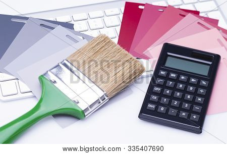 The Photo Shows Various Color Cards With A Flat Brush And A Calculator On A Keyboard