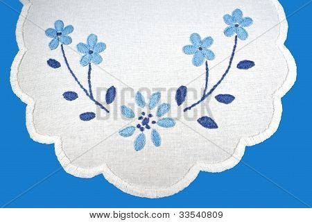 Blue Embroidery On White Linen