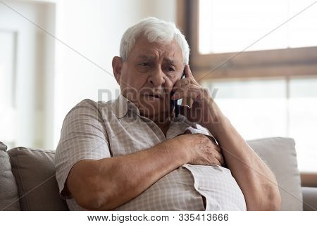 Worried Older Unhealthy Man Making Emergency 911 Call.