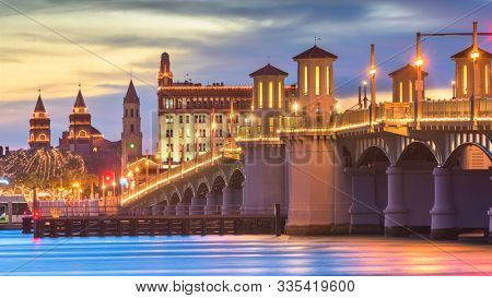 St. Augustine, Florida, USA city skyline and Bridge of Lions at dusk.