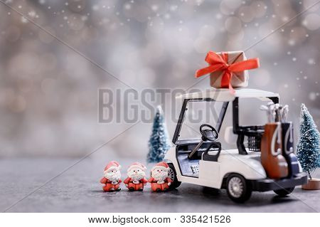 Christmas Decoration With Golf Car And Santa Toy On December.