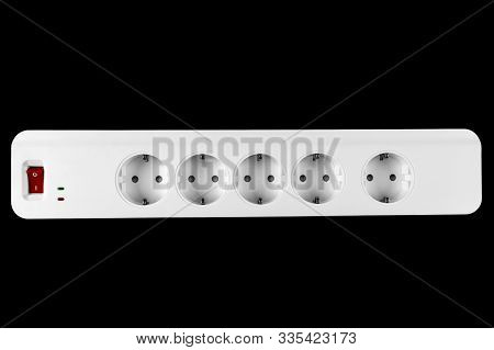 The Surge Protector Isolated On Black Background. Closeup Of Electrical Power Strip On Black Backgro