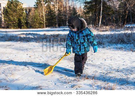 Little Boy On Winter Walk