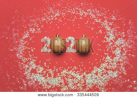 Christmas Card With The Inscription 2020 Of Sparkles And Balls. Coral Background, Gold Decorations F