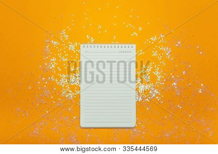 White Notebook On A Red Background With Sparkles. Christmas , Festive Mood, Luxury Party, Winter Hol
