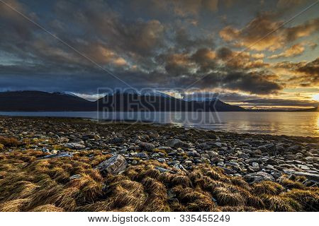 Rocky Beach Near A Fjord Somewher In The Northern Part Of Norway