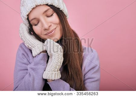 Tender Girl Closed Her Eyes And Folded Her Hands In Mittens Under Her Cheek. Dark-haired Woman In Go