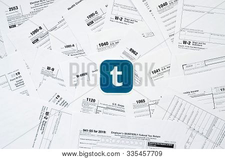 Printed Tumblr Logo On Many Tax Form Blanks Lies On Table Close Up. Help With Tax Problems Using Int