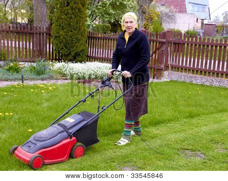 Senior Woman Working With Lawn Mower