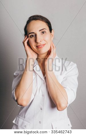 Portrait Of A Beautician Or Doctor In White Uniform. Procedure In Cosmetological Clinic. Mask, Ultra