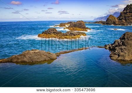 Swimming Natural Pools Of Volcanic Lava In Seixal, Madeira Island, Portugal, Europe. There Is Beauti