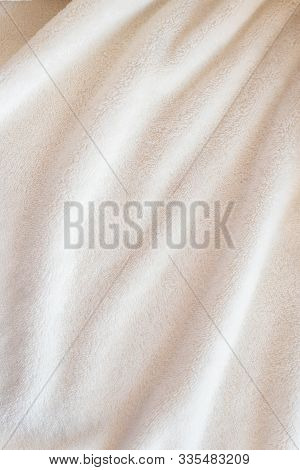 Vertical Beautiful Cozy Plaid Made Of White Plush Fabric With Drapery Pile Lies In Diagonal Soft Fol