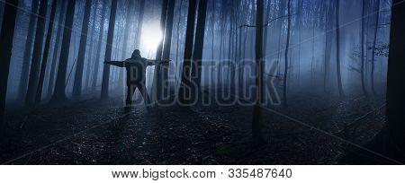 One Alone Man In A Dark Foggy Forest