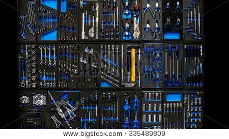 Professional Work Tools Hanging On Wall As Background. Tool On Toolstable