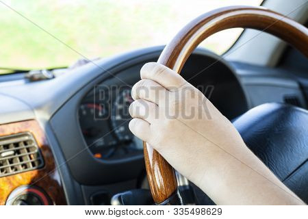A Motorist Drives A Car. Girl Driving. Car Dashboard. The Driver Is Driving. Driving Instruction To
