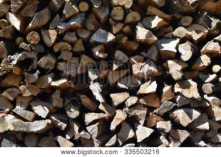 Pile Of Firewood Texture Background. Preparation Of Firewood For The Winter And Use For Cooking, Fir