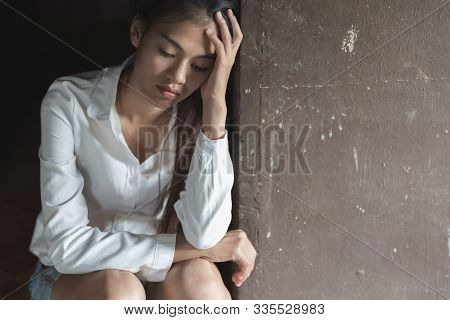 A Woman Sitting Alone And Depressed. The Depression Woman Sit On The Floor, Abuse And People. Sexual
