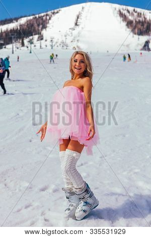 Sheregesh, Kemerovo Region, Russia - April 12, 2019: Young Happy Pretty Woman In Pink On Snow Slope.