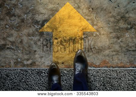 Start And Challenge Concept. A Business Man On Formal Shoes Steps To Follow A Yellow Arrow, Get Read
