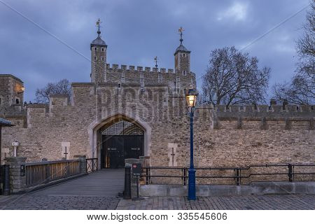 The Old Wooden Gate And Exterior Stone Wall Of The Famous Tower Of London At Sunset In London Englan