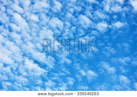 Blue sky with lots small white fleecy clouds - textured background