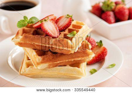 Tasty Belgian Waffles With Berries Closeup View. Crispy Golden Waffles