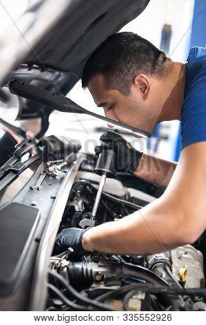 Car Mechanic Repairer Service Technician Checks And Repairs Auto Engine