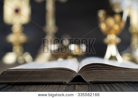 Catholic Concept Background. The Cross, Monstrance,  Holy Bible And Golden Chalice On The Altar.