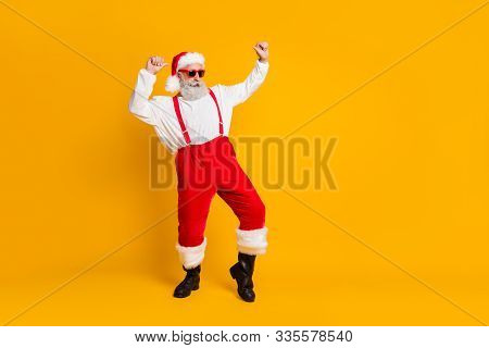Full Length Photo Of Grey Hair Cool Funny Santa Claus In Red X-mas Hat Enjoy Newyear Christmas Magic
