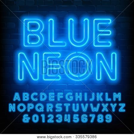 Blue Neon Alphabet Font. Uppercase Neon Light Letters And Numbers. Brick Wall Background. Stock Vect