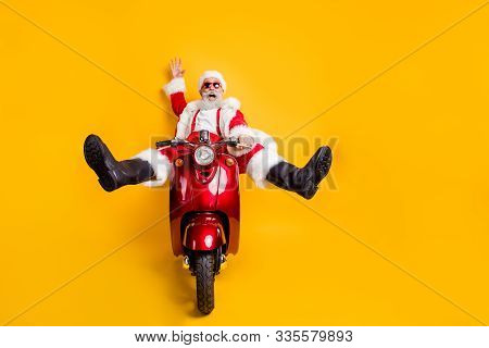 Full Size Photo Of Amazed Funny Crazy Santa Claus In Red Hat Drive Fast Scooter Want Hurry On X-mas