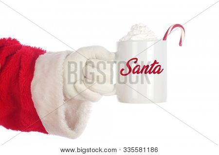 Santa Claus Mug. Santa Coffee Cup. Isolated on white. Room for text. Santa Claus holds a cup of Hot Coco with a Candy Cane and Whip Cream. Santa Loves Hot Coco and Cookies on Christmas.