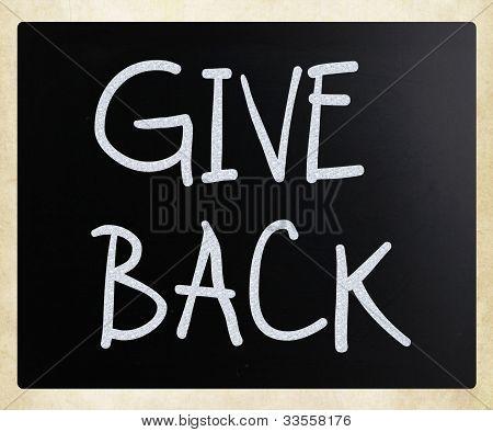 """give Back"" Handwritten With White Chalk On A Blackboard"