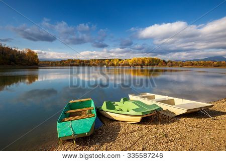 Boats On The Liptovska Mara Dam In The Morning Light At Autumn, The Area Of Liptov In Slovakia, Euro
