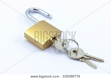 Open Or Unlocked  Padlock With Keys - Pictured On A White Background