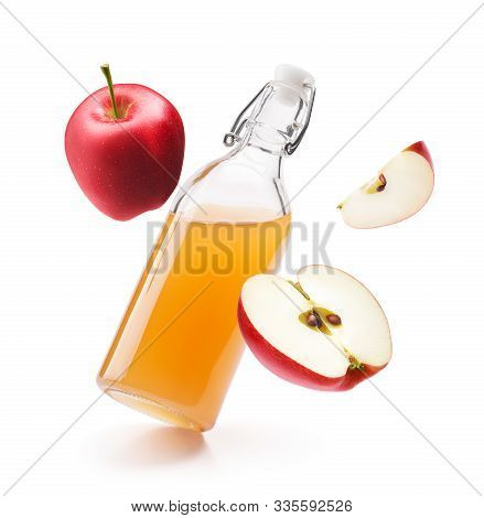 Apple Cider Vinegar With Fresh Red Apples Isolated On White Background