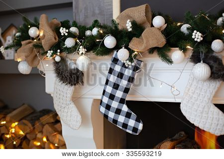 A Close Picture Of Beautifully Decorated White Christmas Socks Hanging On Fireplace Waiting For Pres