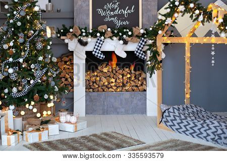 Christmas Interior Of Living Room With Decorated Christmas Tree,  Fireplace With Christmas Socks And
