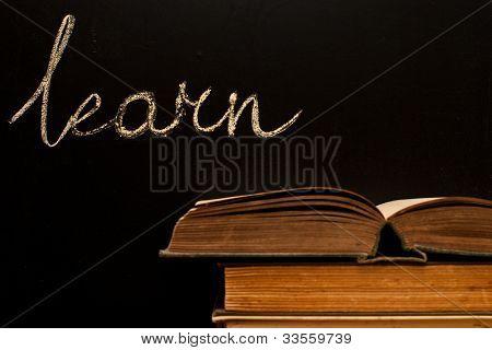 """""""learn"""" Written On Blackboard With Books"""