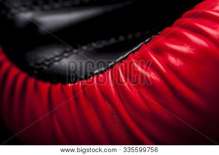 Close-up Elements Of Red-black Boxing Leather Gloves. The Concept Of Protecting Hands And Grips From